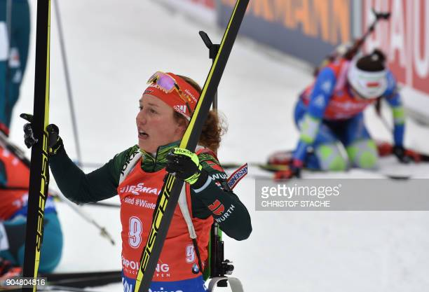 Germany's Laura Dahlmeier reacts in the finish of the women 125 kilometer mass start competition of the Biathlon World Cup on January 14 2018 in...