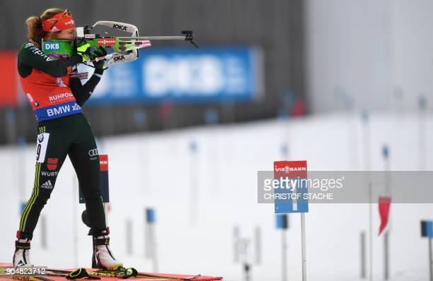 Germany's Laura Dahlmeier shoots during the women's 125 kilometer mass start competition at the Biathlon World Cup on January 14 2018 in Ruhpolding...