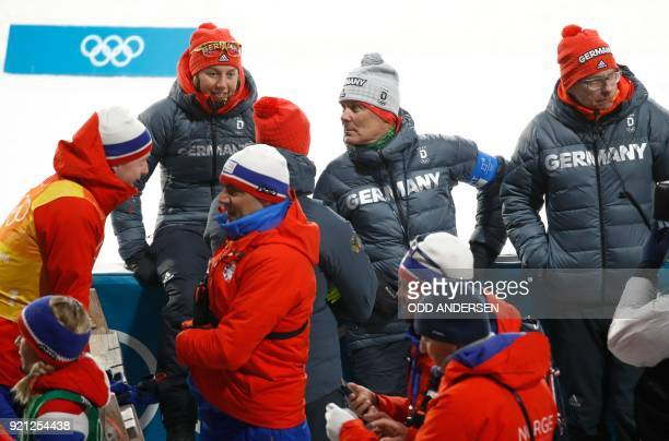 Germany's Laura Dahlmeier sits with team members after the mixed relay biathlon event during the Pyeongchang 2018 Winter Olympic Games on February 20...