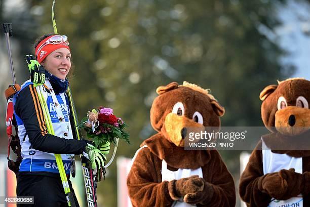 Germany's Laura Dahlmeier smiles on the podium of the women's 75 km Sprint race of the IBU Biathlon World Cup on January 23 2015 in the Italian...