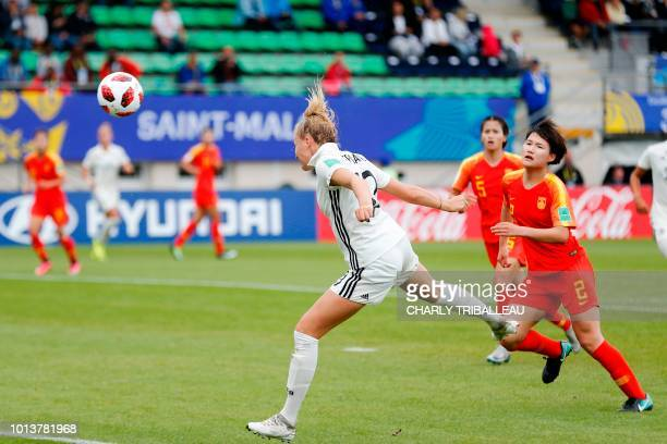 Germany's Laura Freigang heads the ball to score during the Women U20 football World Cup match between Germany and China on August 9 2018 at the...