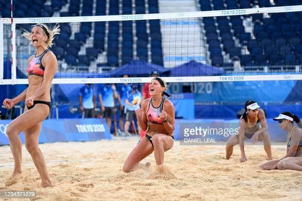 Germany's Laura Ludwig and Germany's Margareta Kozuch celebrate winning, as Brazil's Agatha Bednarczuk and Brazil's Eduarda Santos Lisboa react,...