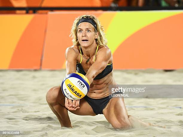 Germany's Laura Ludwig controls the ball during the women's beach volleyball final match between Brazil and Germany at the Beach Volley Arena in Rio...