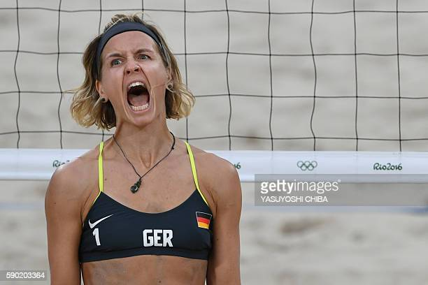 Germany's Laura Ludwig reacts during the women's beach volleyball semi-final match between Brazil and Germany at the Beach Volley Arena in Rio de...