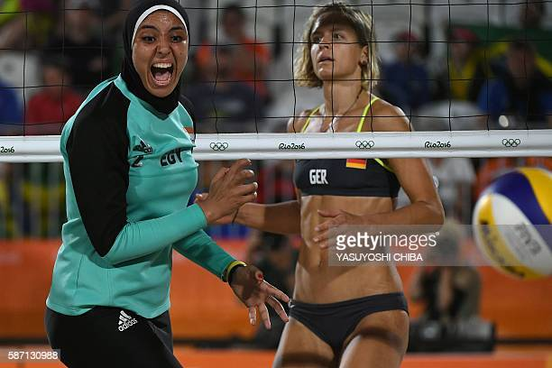 Germany's Laura Ludwig watches as Egypt's Doaa Elghobashy reacts during the women's beach volleyball qualifying match between Germany and Egypt at...