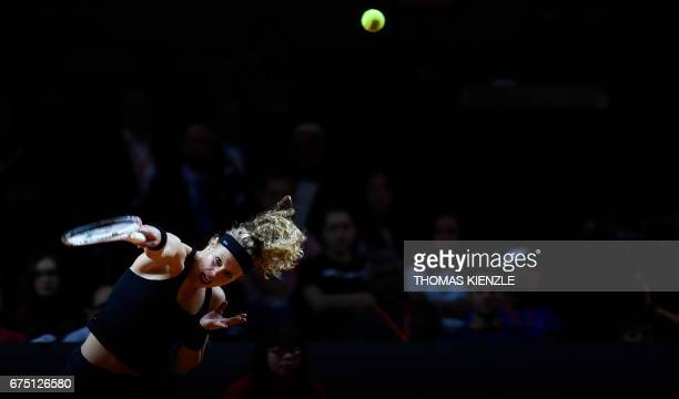 TOPSHOT Germany's Laura Siegemund returns the ball to France's Kristina Mladenovic during their final tennis match at the WTA Porsche Tennis Grand...