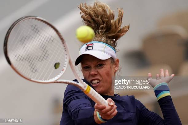 TOPSHOT Germany's Laura Siegemund returns the ball to Switzerland's Belinda Bencic during their women's singles second round match on day four of The...