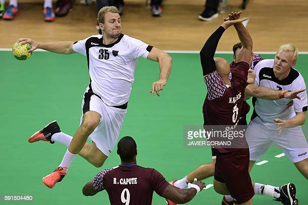 Germany's left back Julius Kuhn jumps to shoot during the men's quarterfinal handball match Germany vs Qatar for the Rio 2016 Olympics Games at the...