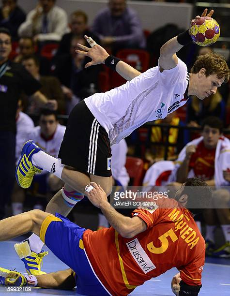 Germany's left back SvenSoeren Christophersen vies with Spain's right back Jorge Maqueda during the 23rd Men's Handball World Championships...