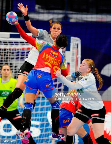 Germany's left back Xenia Smits and Germany's pivot Meike Schmelzer defend against Spain's right back Almudena Rodriguez shooting during the EURO...
