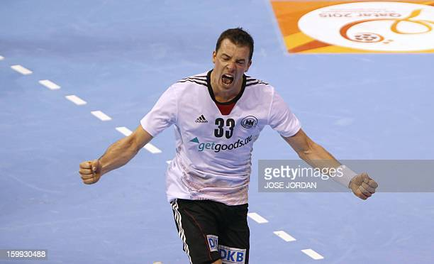 Germany's left wing Dominik Klein celebrates a goal during the 23rd Men's Handball World Championships quarterfinal match Spain vs Germany at the...