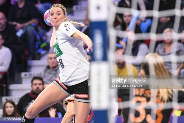Germany's left wing Franziska Muller shoots during the 2018 European Women's handball Championships Group 2 main round match between Netherlands and...