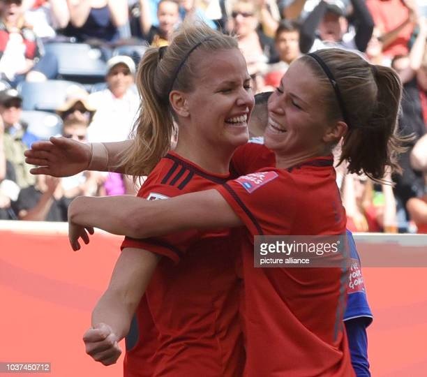 Germany's Lena Petermann celebrate her goal to the 0:2 with Melanie Leupolz during the FIFA Women's World Cup 2015 Group B soccer match between...