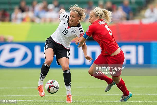 Germany's Lena Petermann keeps the ball from England's Steph Houghton during the bronze medal match at the FIFA Women's World Cup in Edmonton Canada...