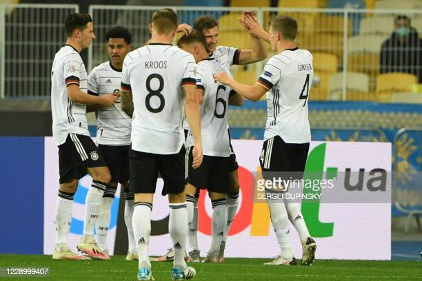 Germany's Leon Goretzka celebrates with teammates after scoring his team's second goal during the UEFA Nations League football match between Ukraine...