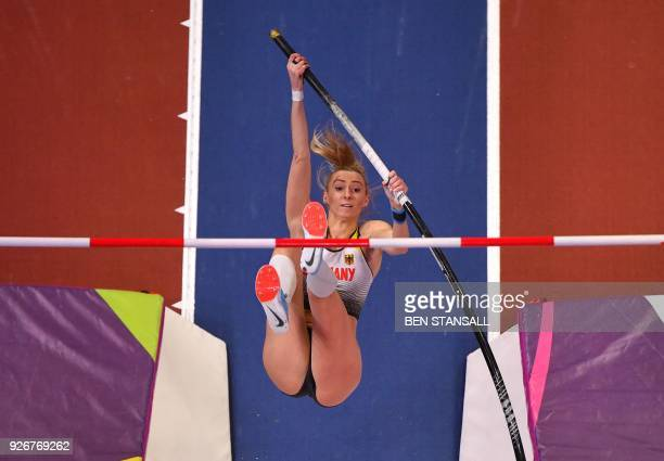 Germany's Lisa Ryzih competes in the women's pole vault final at the 2018 IAAF World Indoor Athletics Championships at the Arena in Birmingham on...