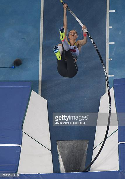Germany's Lisa Ryzih competes in the Women's Pole Vault Final during the athletics event at the Rio 2016 Olympic Games at the Olympic Stadium in Rio...