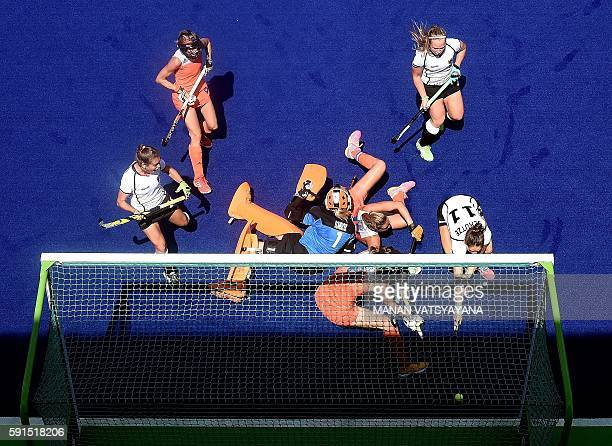 Germany's Lisa Schutze scores a goal during the women's semifinal field hockey Netherlands vs Germany match of the Rio 2016 Olympics Games at the...