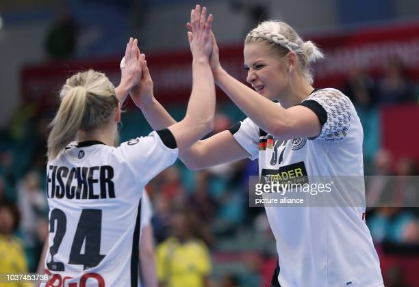 Germany's Lone Fischer and Kim Naidzinavicius celebrate during a handball match between Germany and the DR Congo at the IHF Women's Handball World...
