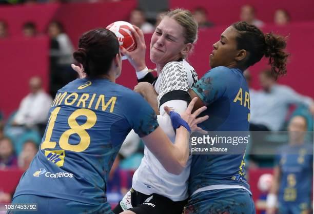 Germany's Luisa Schulze and Eduarda Amorim and Larissa Araujo of Brazil in action during the woman's World Handball Championship in KoldingDenmark...