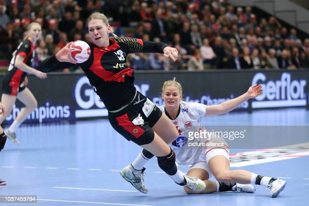 Germany's Luisa Schulze and Norways's Pernille Wibe vie for the ball during the World Women's Handball Championship match between Germany and Norway...