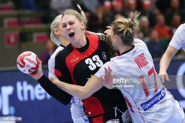 Germany's Luisa Schulze and Norways's Pernille Wibe vie for the ball during the World Women's HandballChampionship match between Germany and Norway...
