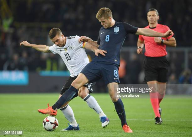 Germany's Lukas Podolski and England's Adam Lallana vie for the ball during the international match between Germany and England at Signal Iduna Park...