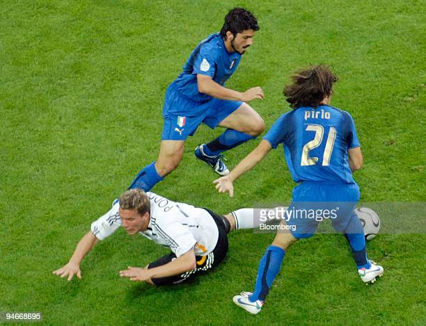 Germany's Lukas Podolski left falls in front of Italy's Gennaro Gattuso center and Andrea Pirlo right during the Germany versus Italy 2006 FIFA World...
