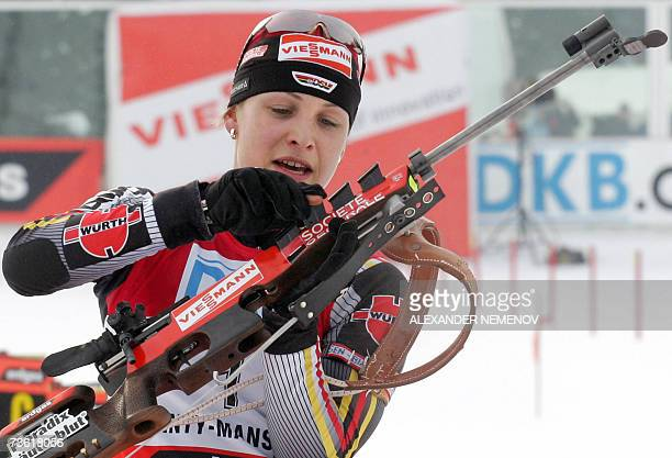 Germany's Magdalena Neuner prepares to shoot as she competes to win the IBU World Cup biathlon final Women's 10 km pursuit17 March 2007 in the...