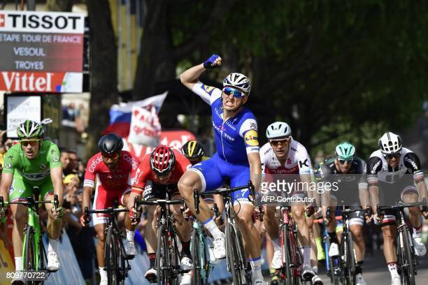Germany's Marcel Kittel celebrates as he crosses the finish line ahead of France's Arnaud Demare wearing the best sprinter's green jersey France's...