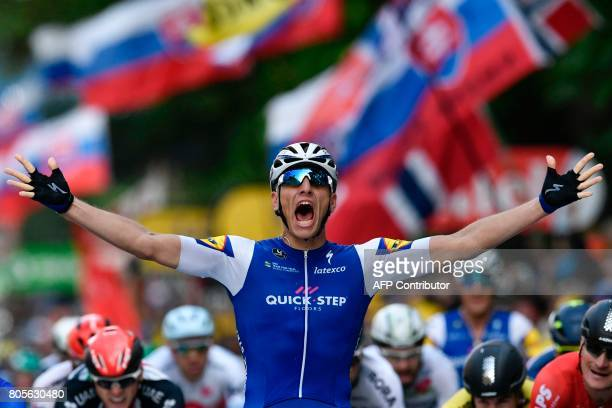 Germany's Marcel Kittel celebrates as he crosses the finish line at the end of the 2035 km second stage of the 104th edition of the Tour de France...