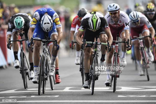 Germany's Marcel Kittel crosses the finish line ahead of Norway's Edvald Boasson Hagen and Norway's Alexander Kristoff at the end of the 2135 km...