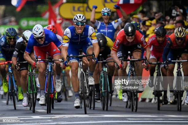 Germany's Marcel Kittel France's Arnaud Demare and Germany's Andre Greipel sprint towards the finish line at the end of the 2035 km second stage of...