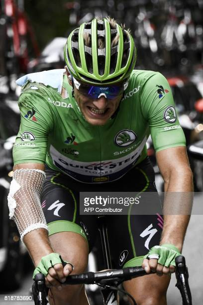 Germany's Marcel Kittel wearing the best sprinter's green jersey injured after falling rides during the 183 km seventeenth stage of the 104th edition...