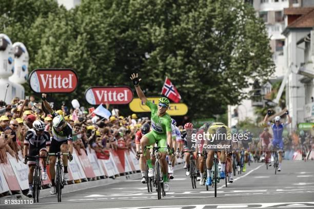 Germany's Marcel Kittel wearing the best sprinter's green jersey celebrates as he crosses the finish line ahead of Australia's Michael Matthews...