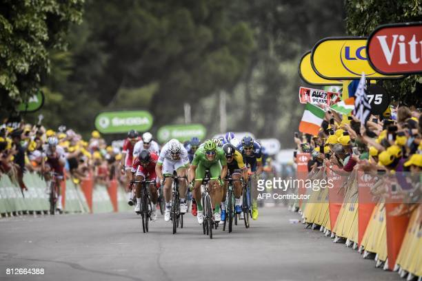 TOPSHOT Germany's Marcel Kittel wearing the best sprinter's green jersey sprints to win ahead of France's Nacer Bouhanni and Netherlands' Dylan...