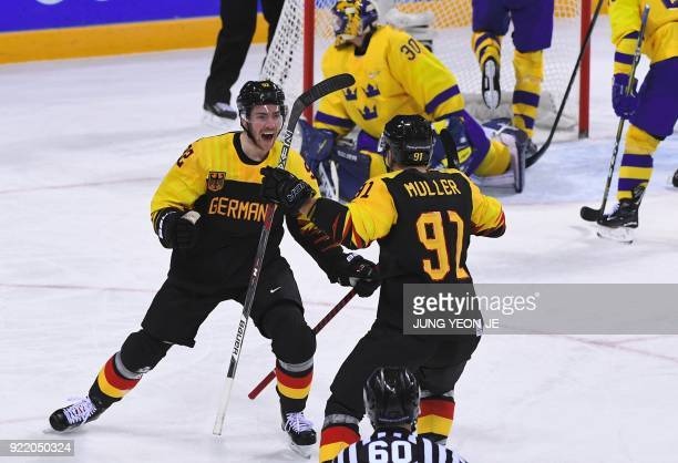Germany's Marcel Noebels celebrates with teammates after a goal in the men's quarterfinal ice hockey match between Sweden and Germany during the...