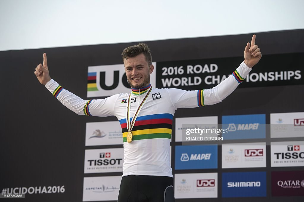 Germanys Marco Mathis celebrates on the podium after winning the gold medal in the men's under 23 individual time trial event as part of the 2016 UCI Road World Championships on October 10, 2016, in the Qatari capital Doha. / AFP / KHALED