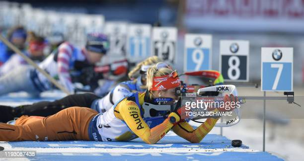 Germany's Maren Hammerschmidt reloads her rifle during the zeroing for the women's 4x6kms relay event at the IBU World Biathlon Championships in...