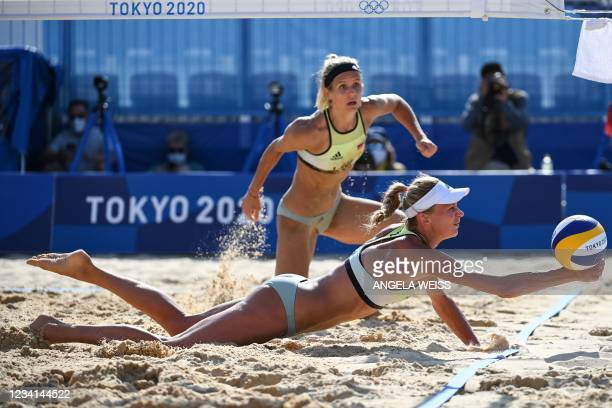 Germany's Margareta Kozuch reaches for the ball in front of partner Laura Ludwig in their women's preliminary beach volleyball pool F match between...