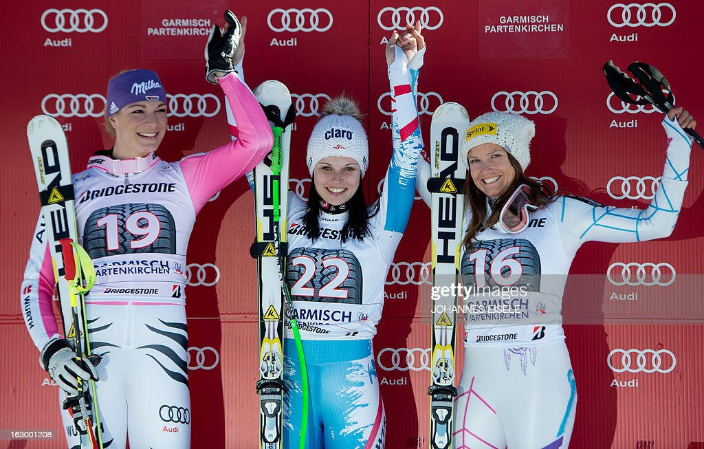 Germany's Maria Hoefl-Riesch 2nd placed, Austria's winner Anna Fenninger and US Julia Mancuso 3rd placed celebrate after the FIS World Cup women's Super G in Garmisch-Partenkirchen, southern Germany, on March 3, 2013.