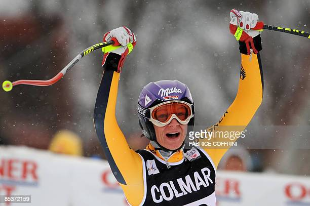Germany's Maria Riesch celebrates after the women's downhill on March 11, 2009 at the Ski World Cup finals in Are. America's Lindsay Vonn on...