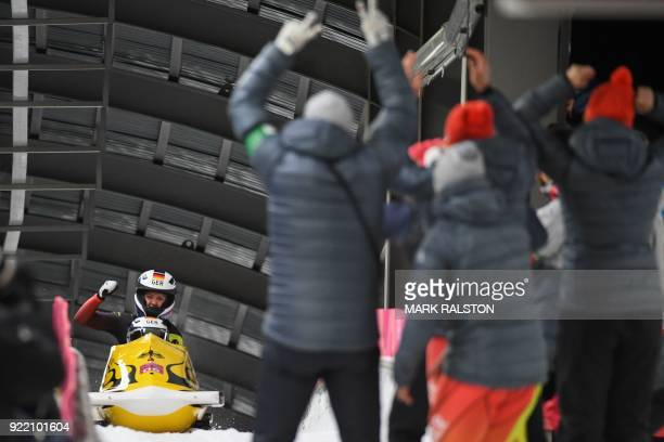 TOPSHOT Germany's Mariama Jamanka and Germany's Lisa Buckwitz celebrate in the women's bobsleigh final 4 heat during the Pyeongchang 2018 Winter...