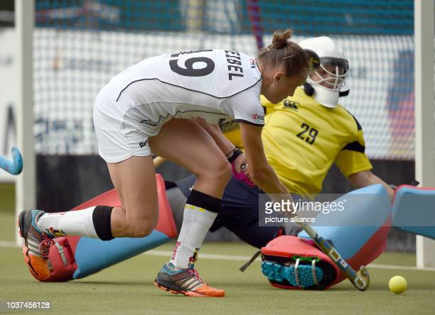 Germany's Marie Maevers and Scotland's goalkeeper Amy Gibson compete for the ball during the women's international hockey match in Hamburg Germany 30...