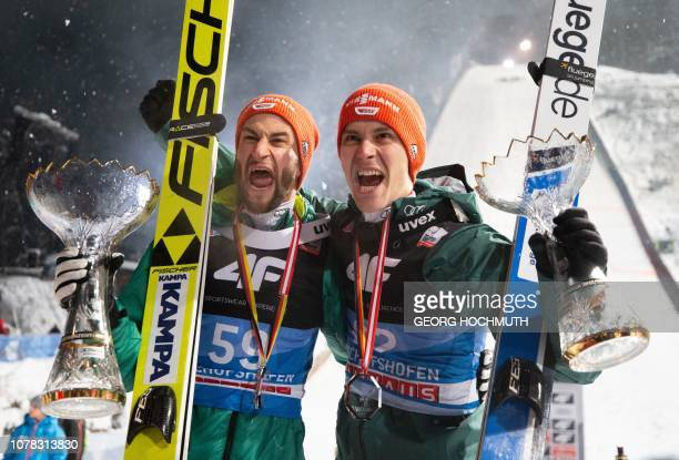 TOPSHOT Germany's Markus Eisenbichler and Stephan Leyhe celebrate after the FourHills Ski Jumping tournament in Bischofshofen Austria on January 6...