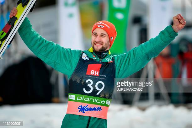 Germany's Markus Eisenbichler celebrates on the podium after winning the FIS Ski Jumping World Cup Flying Hill Individual competition in Planica...
