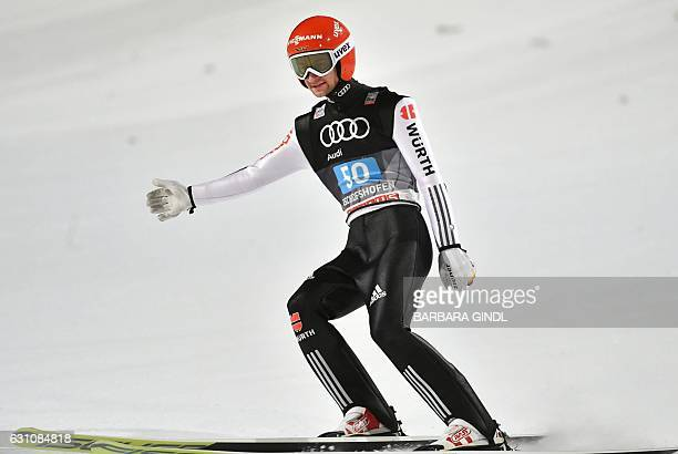 Germany's Markus Eisenbichler reacts after his jump during the ski jumping event in Bischofshofen which is the fourth station of the FourHills Ski...
