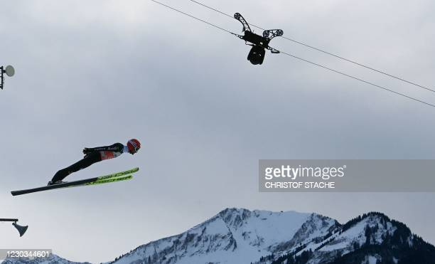 Germany's Markus Eisenbichler soars through the air during the trial round of the Four-Hills Ski Jumping tournament , in Oberstdorf, southern...