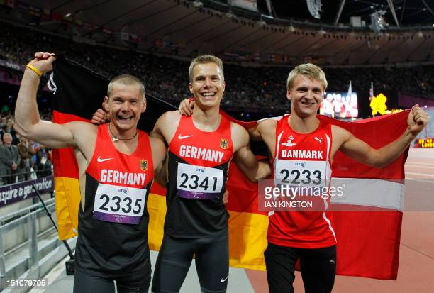Germany's Markus Rehm celebrates after winning ahead of silver medallist Germany's Wojlek Czyz and bronze medallist Denmark's Daniel Jorgensen in the...