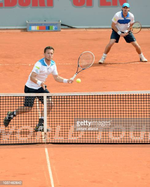 Germany's Martin Emmrich and Christopher Kas in action against Sweden's Johan Brunstroem and Danmark's Frederik Nielsen during the ATP tour at the...